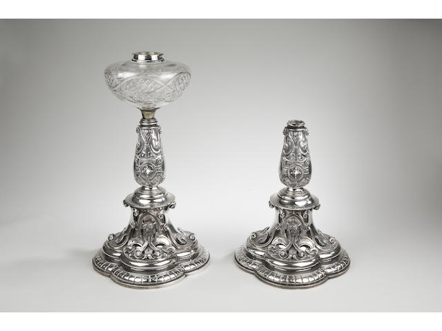A good pair of Aesthetic period cast silver lamp bases by Charles Frederick Hancock, London 1873,