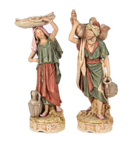 A pair of Royal Dux figures of Arabian water carriers  Circa 1900.