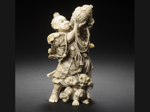 An elaborately carved ivory figural okimono group of Musashibo Benkei and oni By Shimamura Toshimitsu of Tokyo, Meiji Period