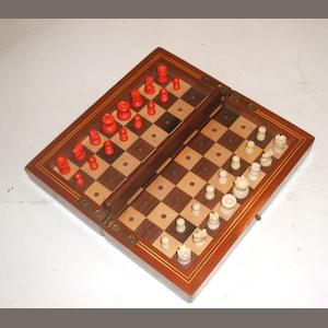 "A ""Whittington Pattern"" travelling chess set, England, late 19th century,"