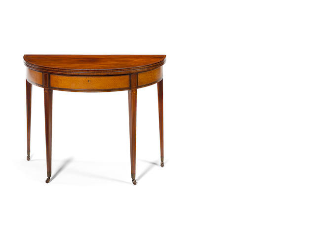 A Regency mahogany, satinwood, tulipwood crossbanded and boxwood inlaid demi-lune Tea Table