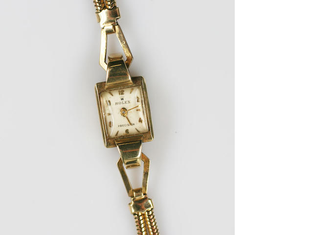 Rolex: A lady's 9ct gold manual wind bracelet watch
