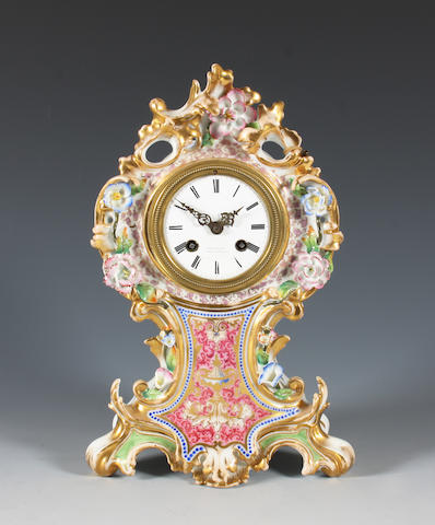 A French porcelain mantel clock Late 19th Century.
