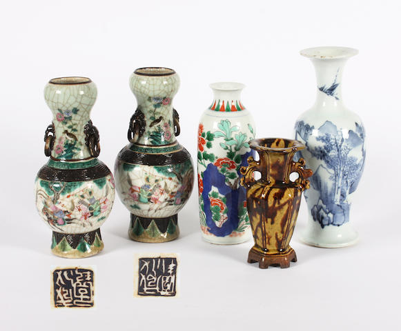 A pair of Chinese famille rose crackle glaze vases, a famille verte vase, a blue and white provincial vase and a Chinese Shiwan twin handled vase 18th Century and later.