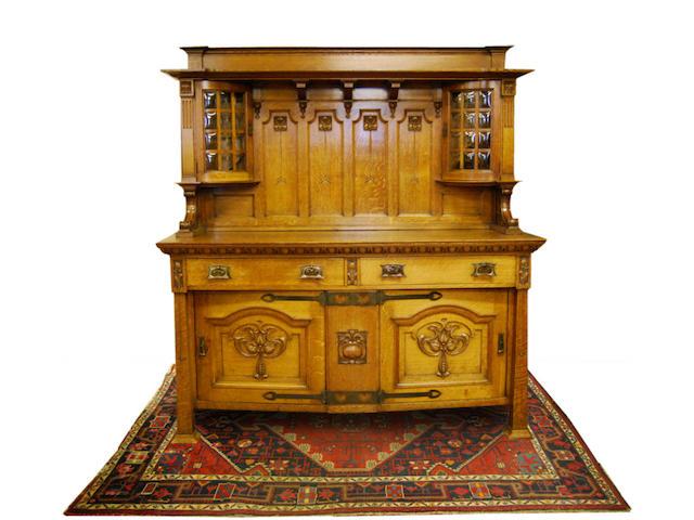 An Arts & Crafts oak sideboard