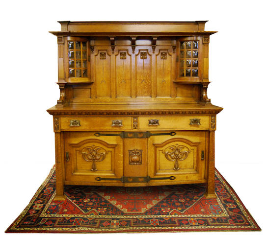 An Arts & Crafts oak sideboard