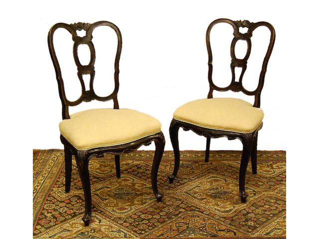 A set of eight Continental walnut dining chairs