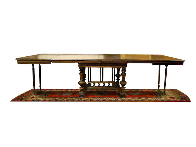 A Continental walnut draw-leaf dining table, late 19th Century