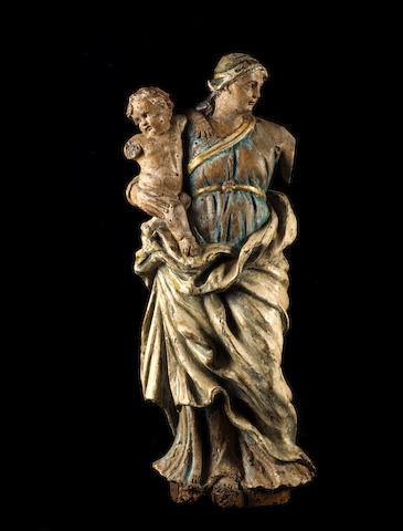 An 18th century French carved wood and polychrome decorated figure of the Virgin and Child