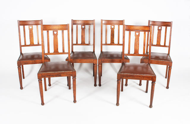 A set of six oak standard chairs in the style of William Birch, circa 1900