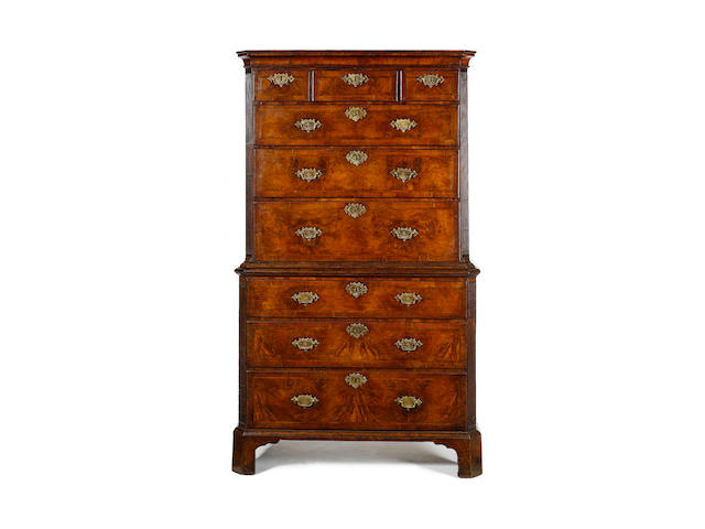 A George I walnut crossbanded and featherbanded Chest on Chest