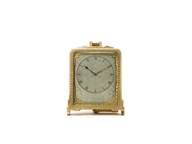 A mid 19th century engraved gilt brass strut timepiece The movement signed Thos. Cole, numbered 1880