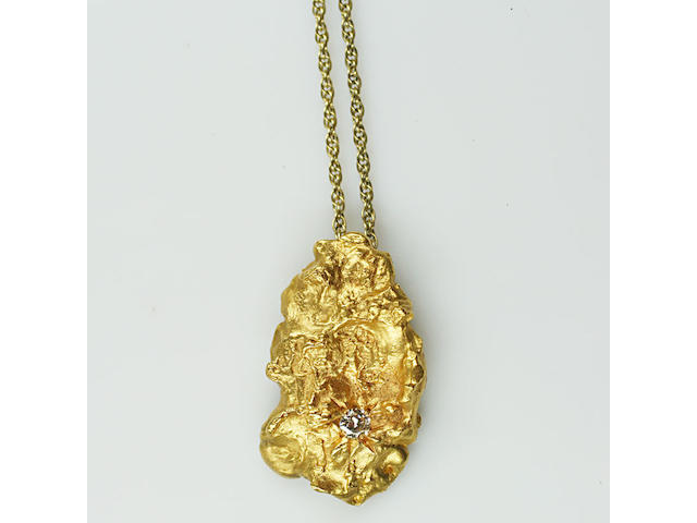 A diamond set gold 22ct gold 'nugget' pendant