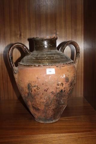 A large decorative earthenware twin handled jar