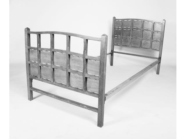 A good pair of chamfered oak frame single beds attributed to Ernest Gimson, early 20th century