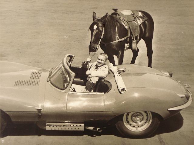 A publicity photograph of Steve McQueen in his Jaguar XK-SS, with 'Doc',