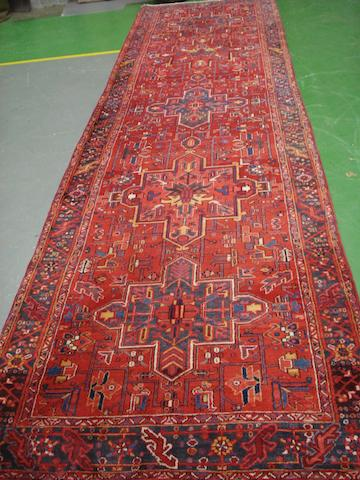 A Heriz runner, North West Persia, 461cm x 125cm