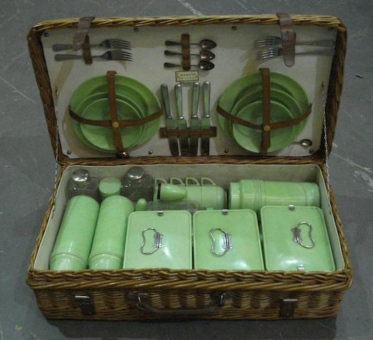 A four-person wicker picnic set by Coracle, for Fortnum & Mason,