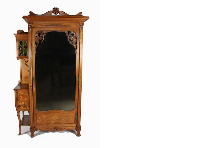 A good French Art Nouveau carved and inlaid walnut four piece bedroom suite in the Majorelle style, circa 1900