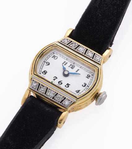 An enameled eighteen karat gold lady's diamond-set wristwatch