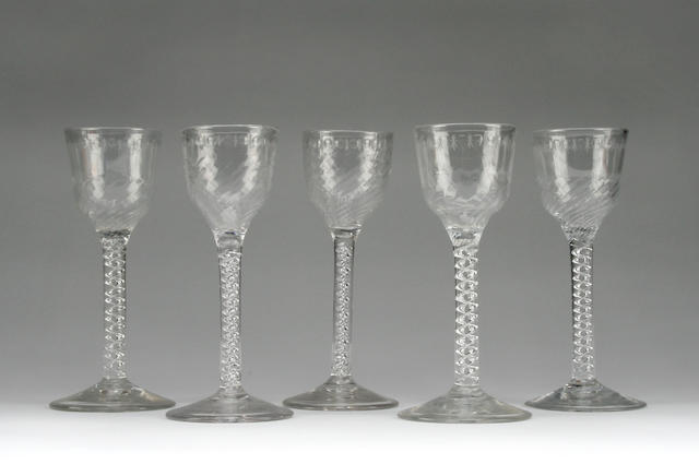A collection of three air twist wine glasses Circa 1770