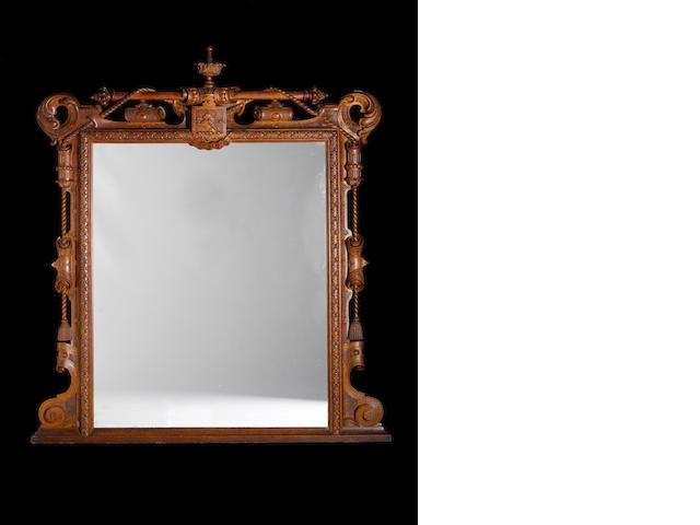 A Victorian carved oak Overmantel Mirror by James Plunkett & Co. of Warwick