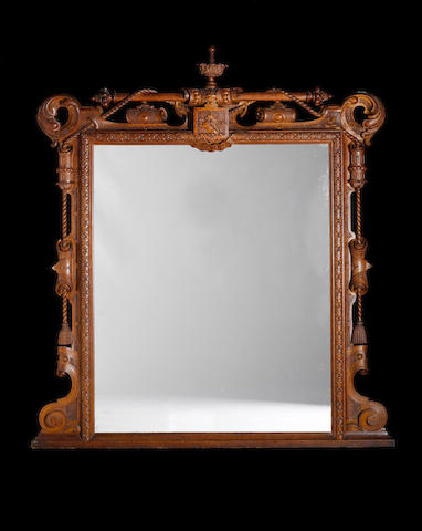 A Victorian carved oak Overmantel Mirror by James Plunkett & Co. of Warwick