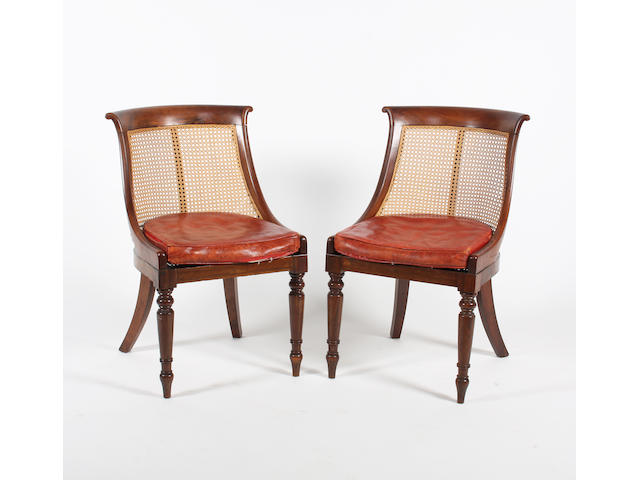 A pair of George IV goncalo alves bergere library side chairs