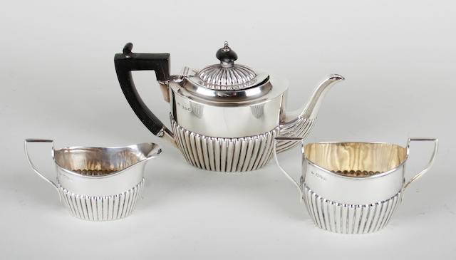 A late Victorian silver three piece batchelor's teaset by Frederick Wilson, Chester 1895,  (3)