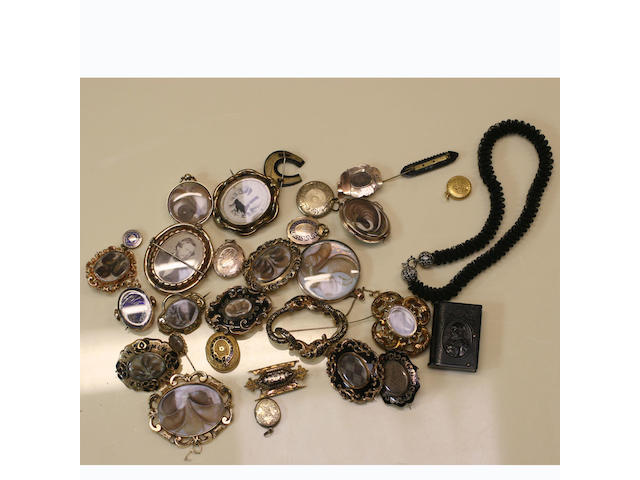 A collection of memorial brooches and lockets,