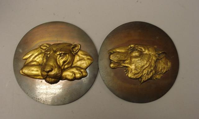 Two Leyland plaques with a gilt panther and a gilt lion,