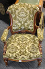 A mid-Victorian walnut framed drawing room open armchair,