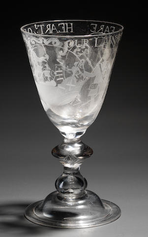 An interesting engraved mammoth heavy baluster goblet of military and masonic significance The glass circa 1720.