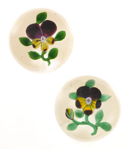 Two Baccarat purple pansy paperweights circa 1850