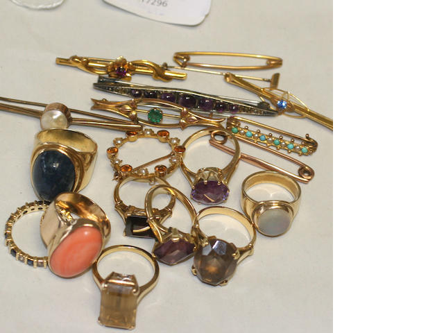A collection of dress rings and bar brooches,