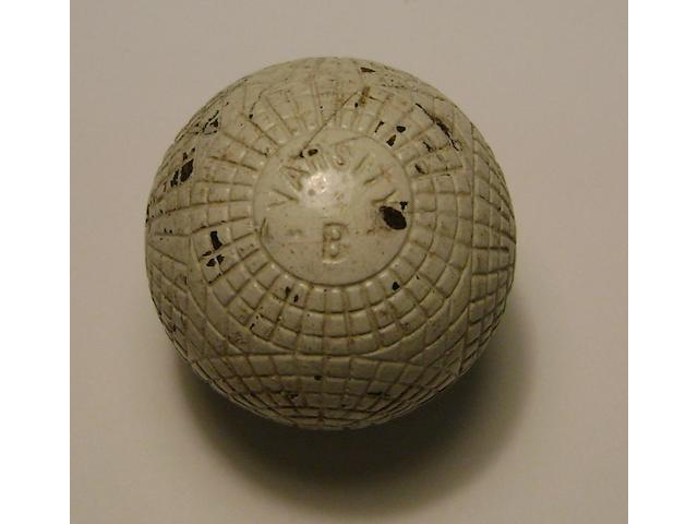 A very good Varsity B moulded mesh gutta-percha golf ball circa 1890