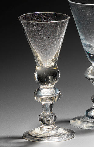A heavy baluster wine glass with mushroom knop Circa 1715.