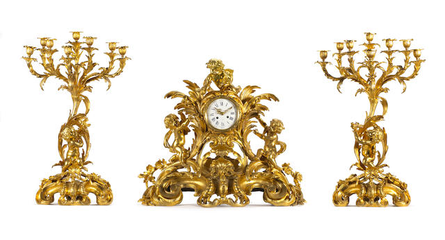 A very large French 19th century Louis XV style gilt bronze three-piece clock garniture