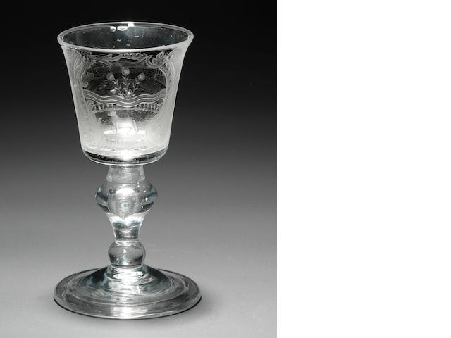 A Dutch engraved armorial baluster goblet Circa 1750.