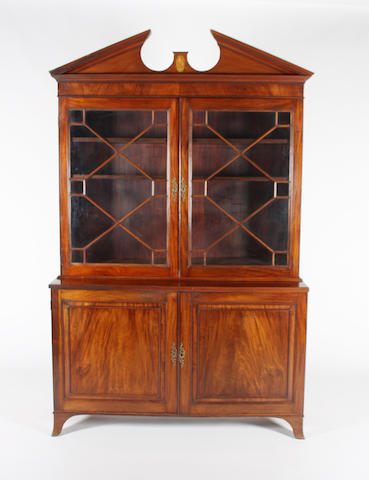 A George III and later, figured mahogany library bookcase