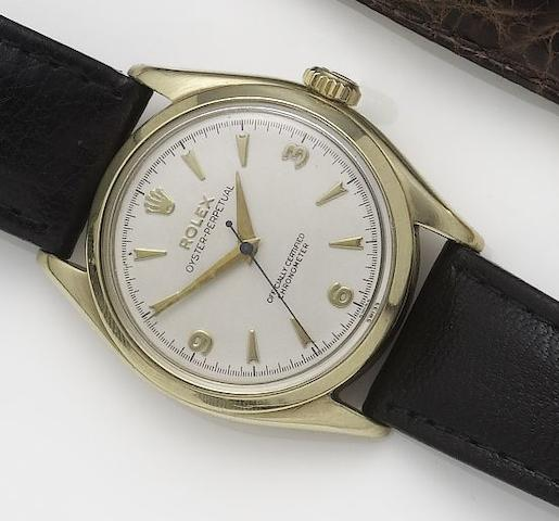 Rolex. A 9ct gold automatic centre seconds wristwatch