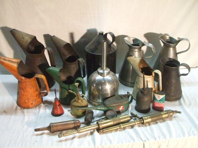 A quantity of oil cans, jugs and grease guns.