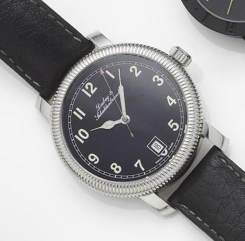 Dubey & Schaldenbrand. A stainless steel automatic centre seconds calendar wristwatch together with fitted box and papers