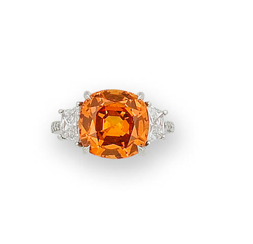 A spessartite garnet and diamond ring