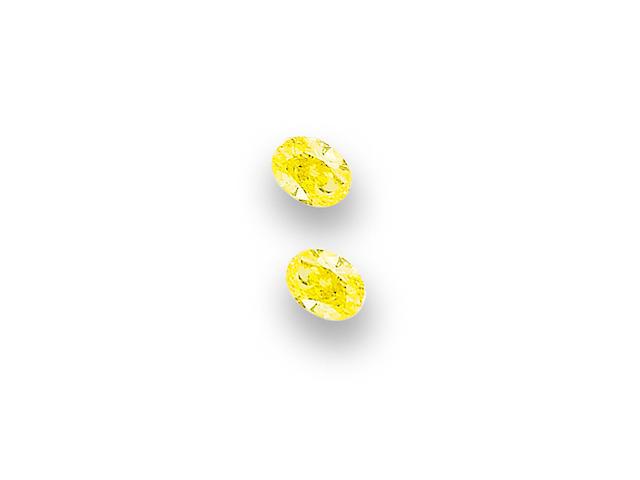 A pair of coloured diamond ear studs