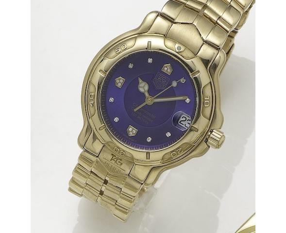 Tag Heuer. An 18ct gold automatic calendar bracelet watchAuto,6000, Recent