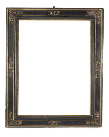 An Italian late 16th Century ebonised and parcel gilt cassetta frame
