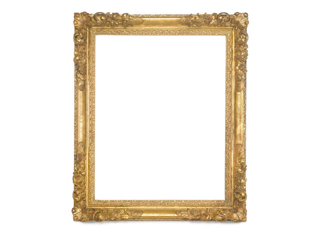 A Louis XIV carved, pierced and gilded Lebrun frame