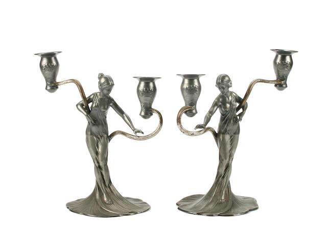 Wurttembergische Metallwaren Fabrik; A pair of pewter candelabra, circa 1906,