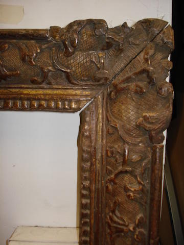 A Louis XIV carved and gilded frame